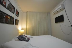 A bed or beds in a room at Yatch Village Flat