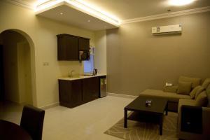 A cozinha ou cozinha compacta de Al Nakhlah Furnished Units