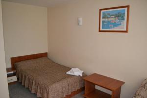 Кровать или кровати в номере Гостиница Синегорье