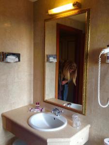 Um banheiro em Hotel Amadeus