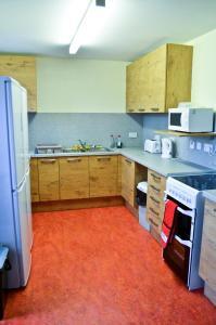 Cuisine ou kitchenette dans l'établissement Darroch Court - Self Catering Flats