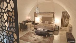 Letto o letti in una camera di Dimora Storica Torre Del Parco 1419