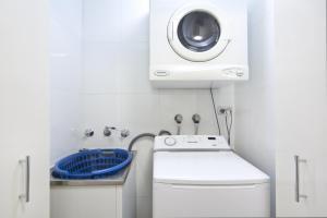 A bathroom at Astra Apartments Sydney - Kent Street