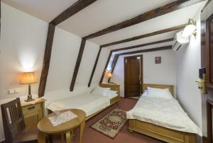 A bed or beds in a room at Hotel Cerny Slon