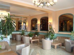 The lobby or reception area at Hotel Le Dome