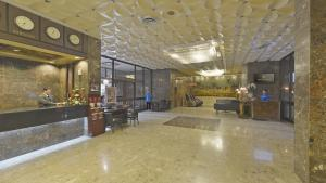 The lobby or reception area at Astoria Hotel