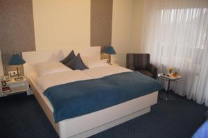 A bed or beds in a room at Hotel Christine