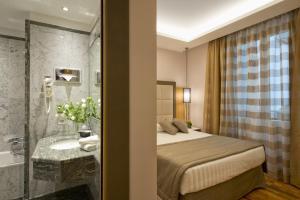 Ванная комната в Hotel Giolli Nazionale