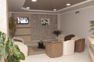 O saguão ou recepção de Hotel Joaçaba