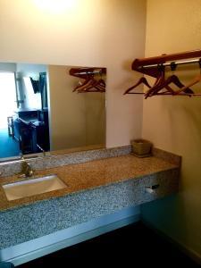 A bathroom at Coral Roc Motel