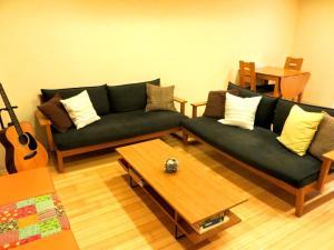 Een zitgedeelte bij K's House Hiroshima - Travelers Hostel