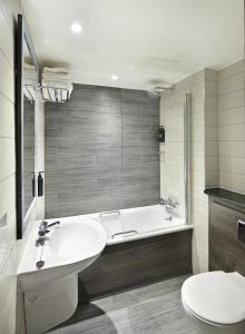 A bathroom at Village Hotel Aberdeen