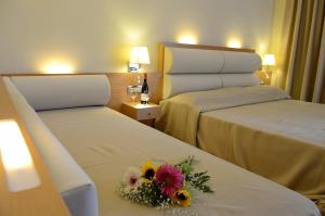 A bed or beds in a room at Maritina Hotel