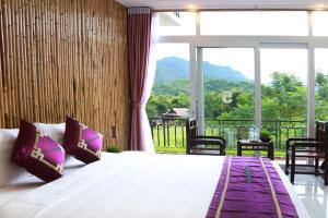 Giường trong phòng chung tại Mai Chau Sunset Boutique Hotel
