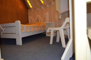 A bed or beds in a room at Hotel Veles