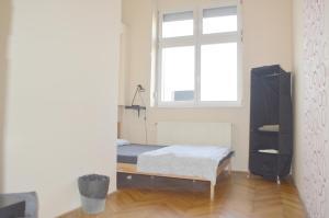 Un ou plusieurs lits dans un hébergement de l'établissement Artist Guest House