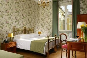 A bed or beds in a room at Hotel Pendini