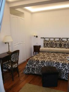 A bed or beds in a room at Diva La Canzone Del Mare