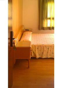 Cama o camas de una habitación en Hostal Centro Ejido