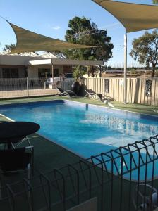 The swimming pool at or near Mia Motel