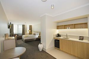 A kitchen or kitchenette at Clarion Hotel Townsville