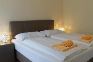 Ein Bett oder Betten in einem Zimmer der Unterkunft Starapartments