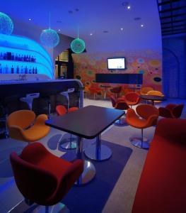 El salón o zona de bar de Hotel Garden Palace