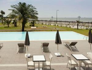 The swimming pool at or near Ibis Bata