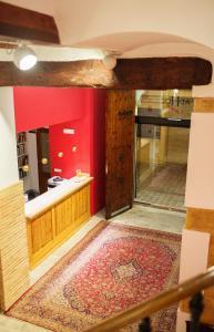 The lobby or reception area at Ad Hoc Carmen