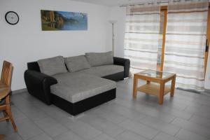 Ein Sitzbereich in der Unterkunft Ferienwohnung Graf