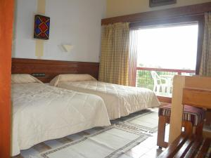 A bed or beds in a room at Sidi Harazem