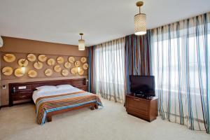 Кровать или кровати в номере Отель Иркутск