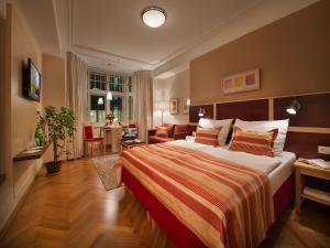A bed or beds in a room at EA Hotel Julis