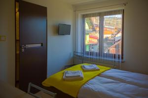 A bed or beds in a room at U Pazdurka