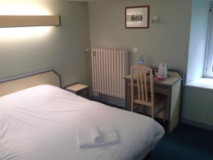 Un ou plusieurs lits dans un hébergement de l'établissement Hotel Set A Table