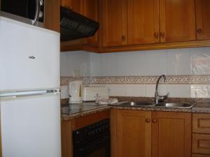 A kitchen or kitchenette at Gemelos 22 - Zand Properties