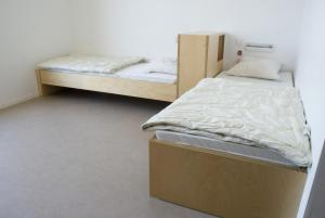 A bed or beds in a room at Youth Hostel Echternach