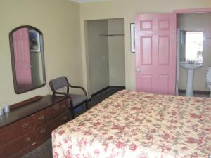 A bed or beds in a room at Royal Relax Inn