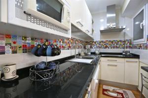 Una cocina o zona de cocina en Apartment Vasco de Gama