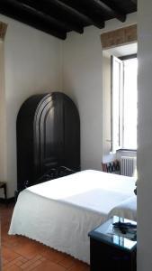 Ein Bett oder Betten in einem Zimmer der Unterkunft Hotel Andreina