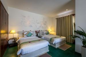 A room at VMANSION Boutique Hotel