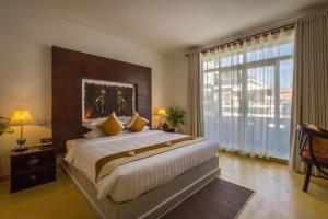 A bed or beds in a room at VMANSION Boutique Hotel