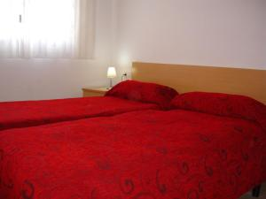 A bed or beds in a room at Gemelos 22 - Zand Properties