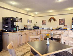 A restaurant or other place to eat at Super 8 by Wyndham West Springfield/Route 5