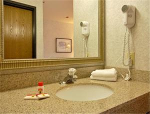 A bathroom at Super 8 by Wyndham West Springfield/Route 5
