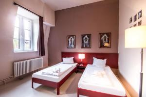 A bed or beds in a room at PLUS Berlin Hostel und Hotel