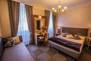 מיטה או מיטות בחדר ב-Hotel Romano