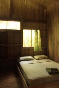 Kama o mga kama sa kuwarto sa Sabalo Lodge