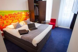 Un ou plusieurs lits dans un hébergement de l'établissement ibis Styles Amsterdam City
