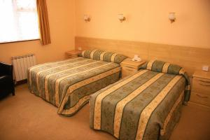 A bed or beds in a room at Stafford Hotel